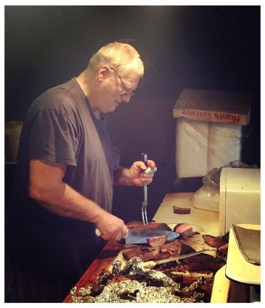 Steve Kapchinskie slicing a brisket.