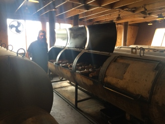Carl checks the meat on one of the five enormous smokers at Franklin Barbecue.