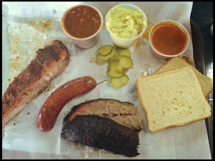 Three meats: beef brisket (moist), pork rib and original sausage. Potato salad, beans, sauce and fixings.